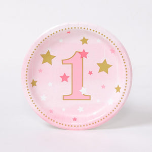 A small, round, pink-pastel party plate with gold and white stars for a 1st birthday