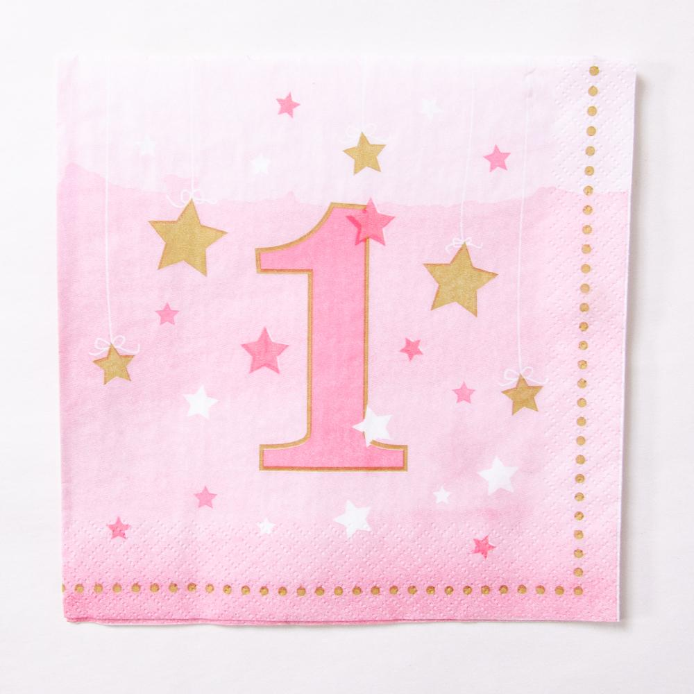 A pink pastel party napkin with gold stars and number 1 for a 1st birthday party