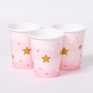 A set of 3 pink pastel and gold star covered party cups for a 1st birthday celebration