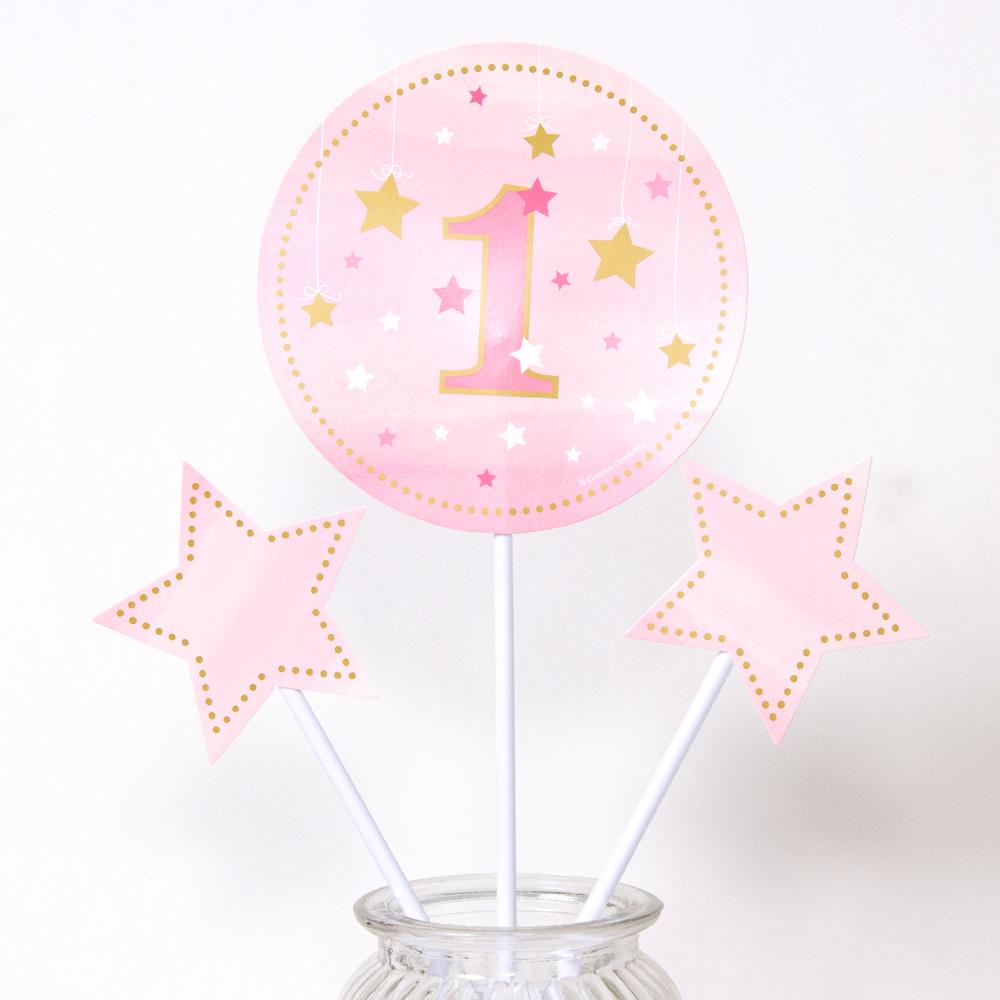 A set of 3 pastel pink table centrepieces for a 1st birthday party table