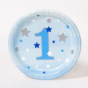 A small, round, pastel blue 1st birthday party plate decorated with silver and blue stars