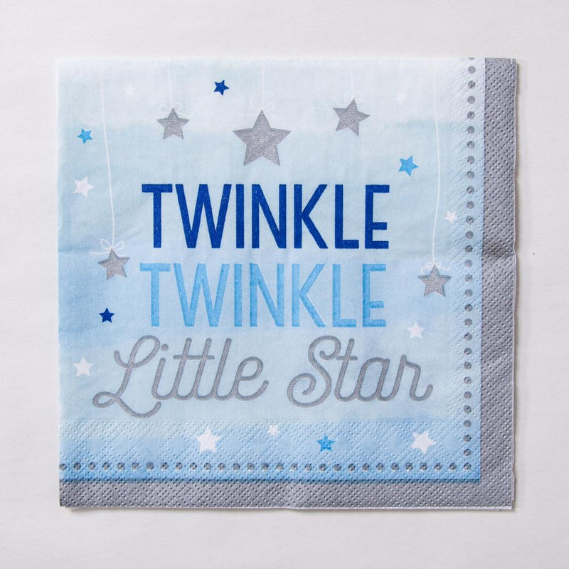 A first birthday party napkin with a pastel blue design and