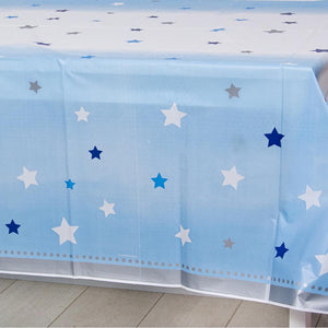 A pastel blue 1st birthday table cover covered in blue and silver stars