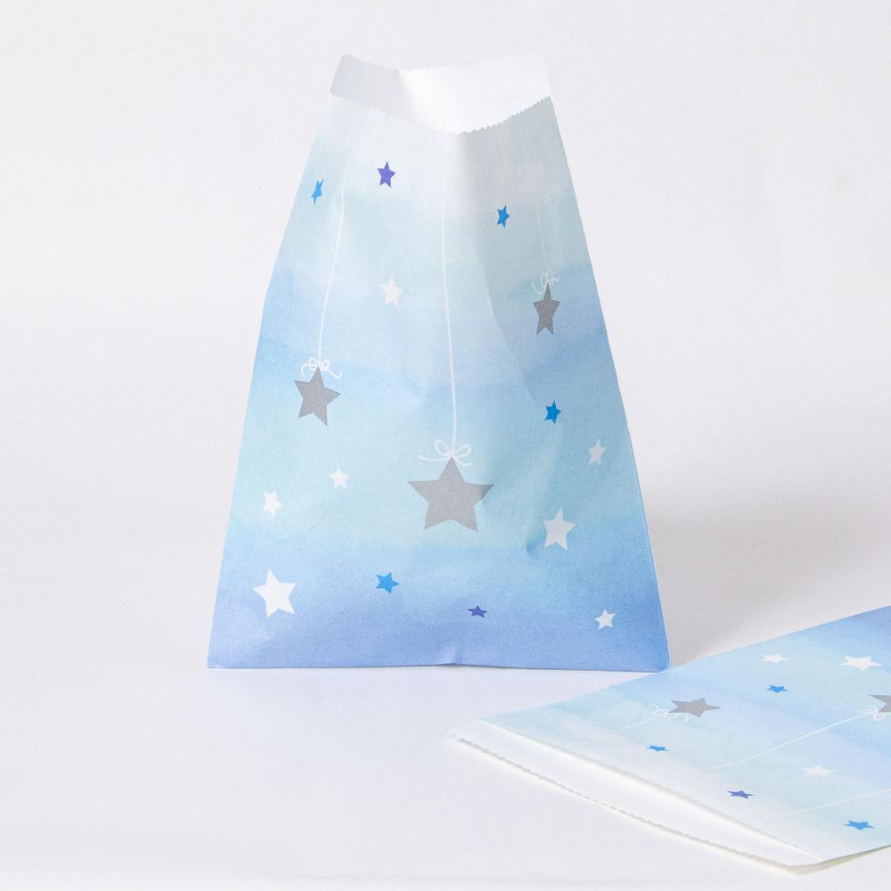 A pastel blue 1st birthday party bag with shimmery silver star design