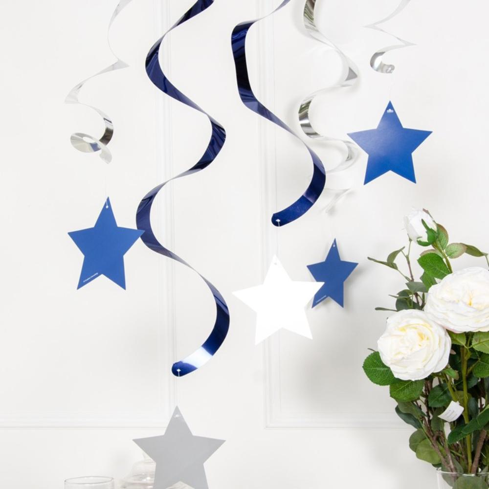 Dangling party decorations with blue and white stars and swirls