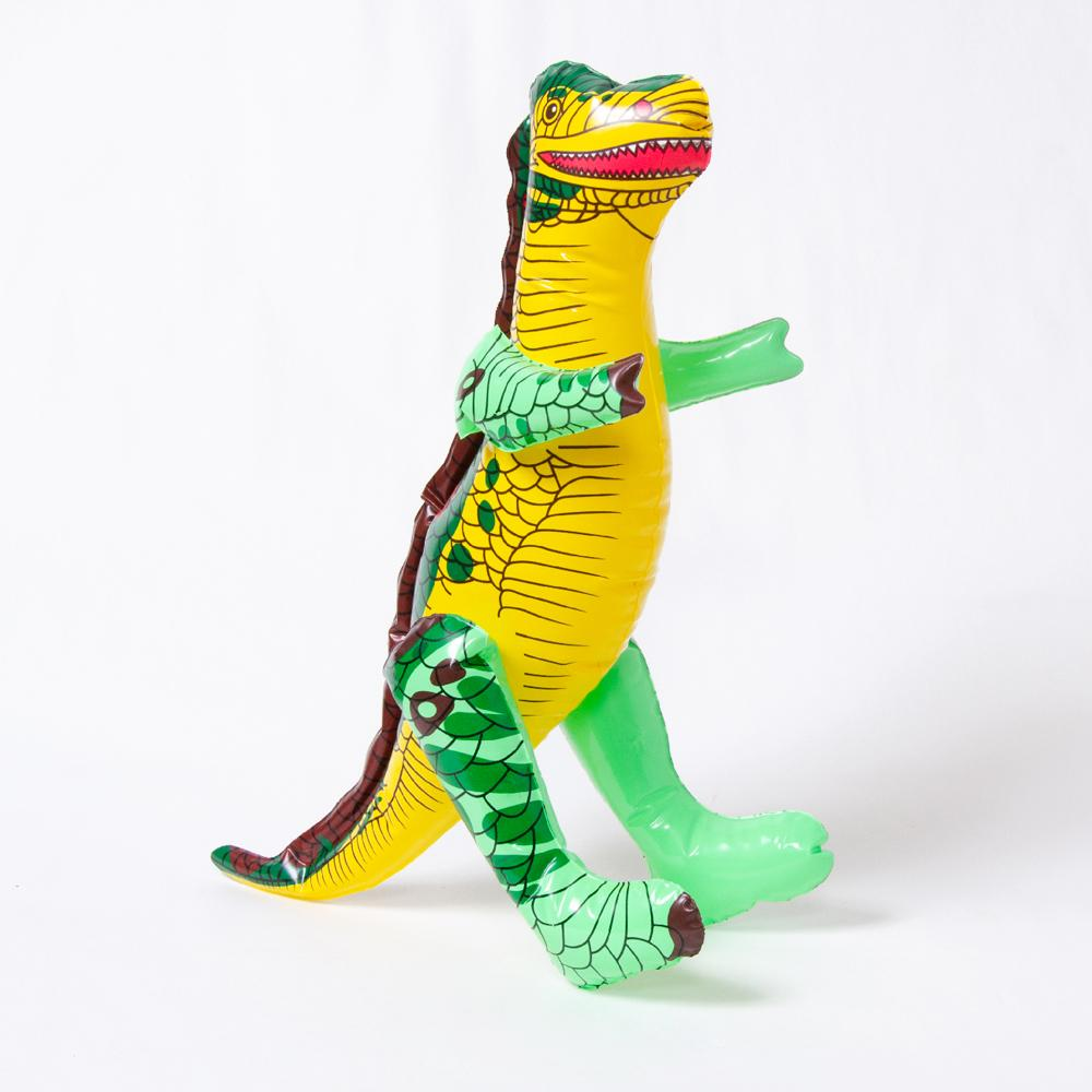 An inflatable green and yellow dinosaur
