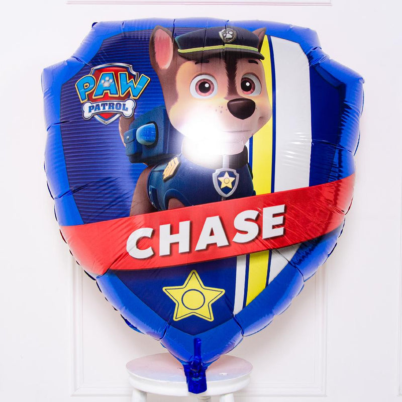 A Paw Patrol-themed helium balloon featuring the character Chase