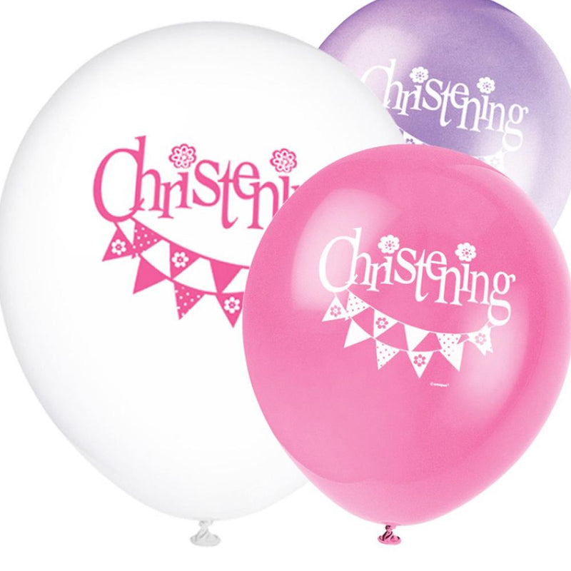 A bunch of 3 pink balloons with a garland print and Christening lettering