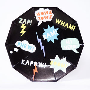 A superhero party plate featuring a comic book sound effect design