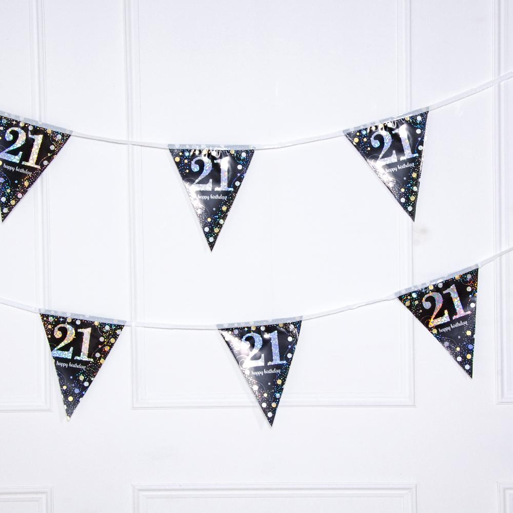 A party bunting banner with black and sparkly star 21st birthday pennants