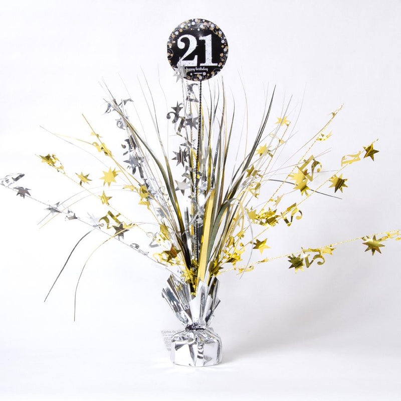 A large silver and gold party centrepiece spray with a big 21st birthday roundel at the top