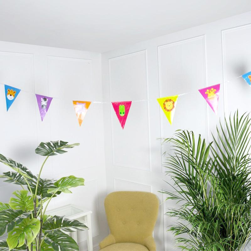 A party flag bunting with jungle animal pennants