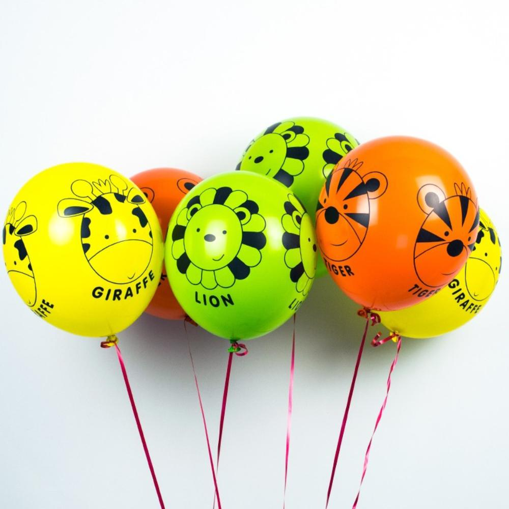 A bunch of colourful latex party balloons with jungle animal drawings