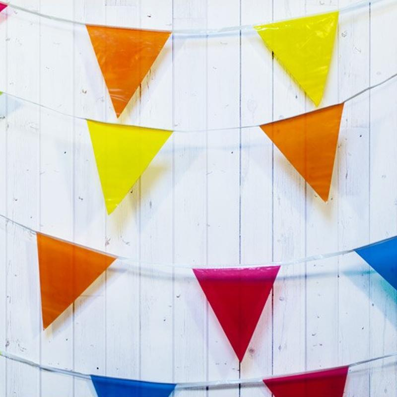 A multicoloured flag bunting with colourful pennants