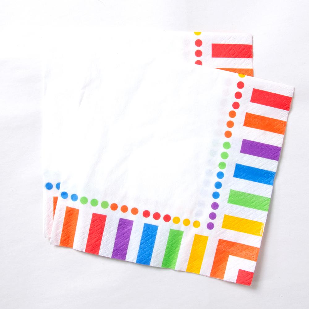 A set of rainbow-striped paper party napkins
