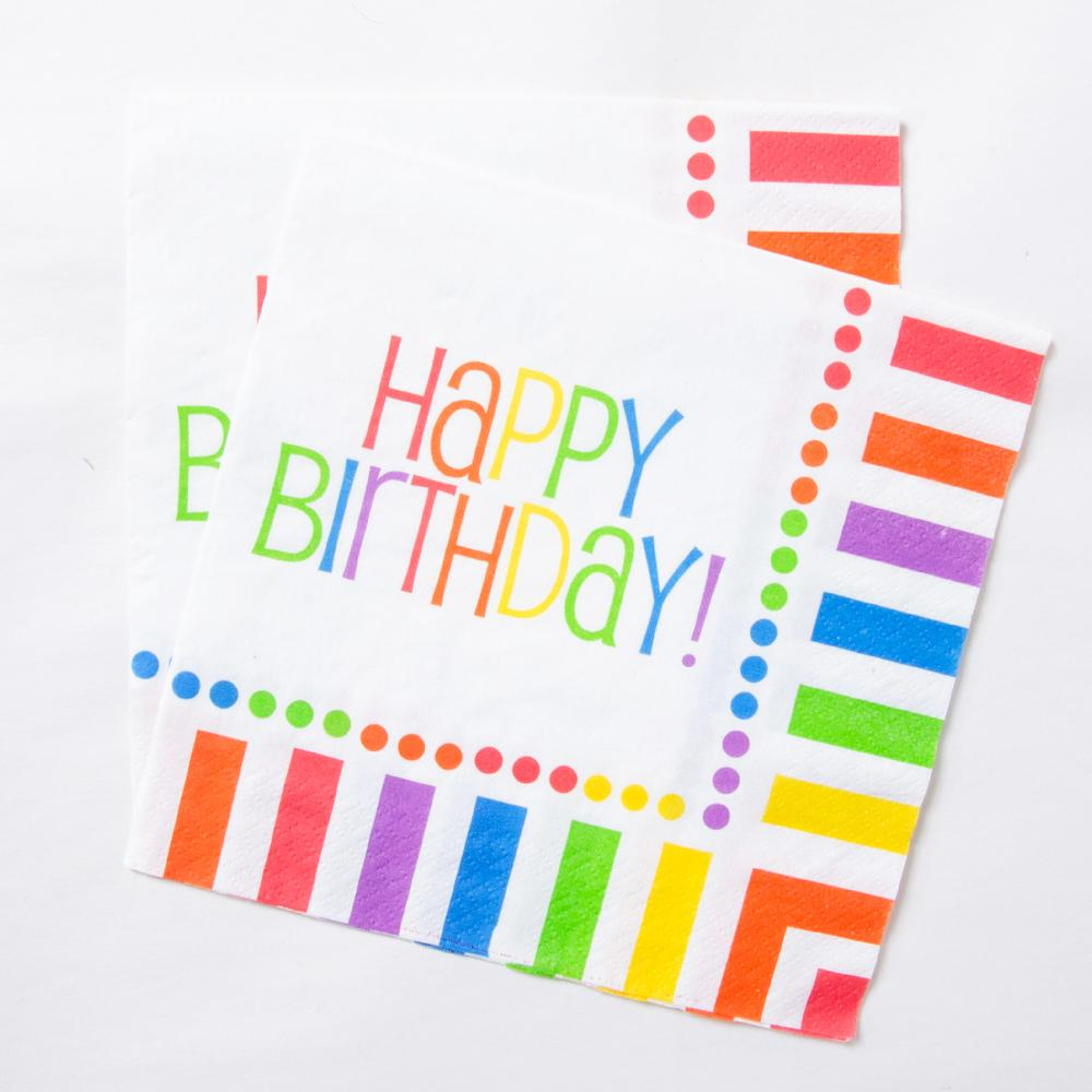 A set of paper party napkins with a colourful rainbow stripe design