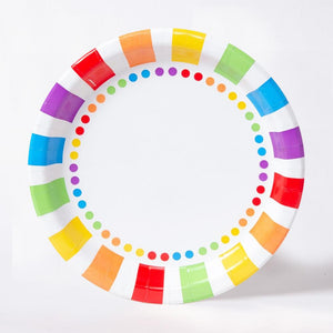 A round paper party plate with a stripy, rainbow-coloured design