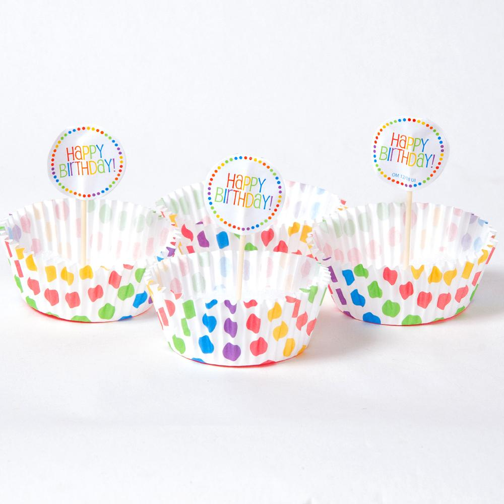 A set of cupcake wrappers and toppers with a polkadot rainbow design
