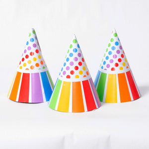 3 conical party hats with a polkadot, rainbow-striped design