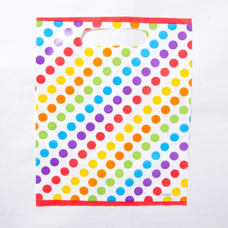 A party bag covered in rainbow-coloured polkadots