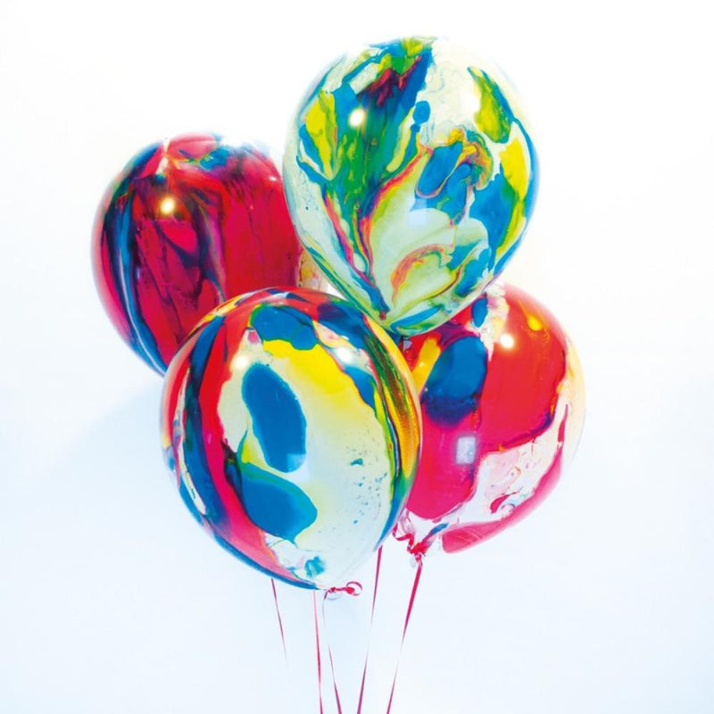 A bunch of latex party balloons with a colourful swirly pattern