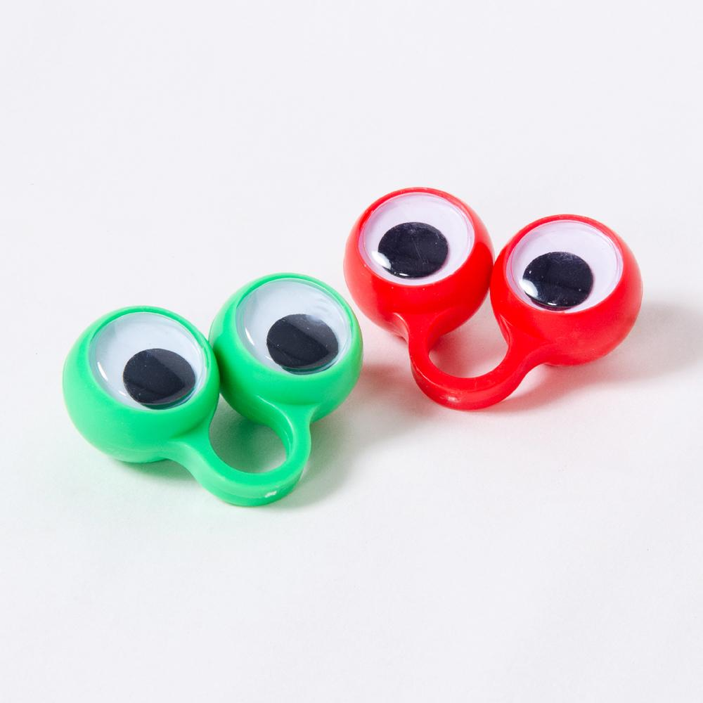 2 googly-eyed finger toys in red and green