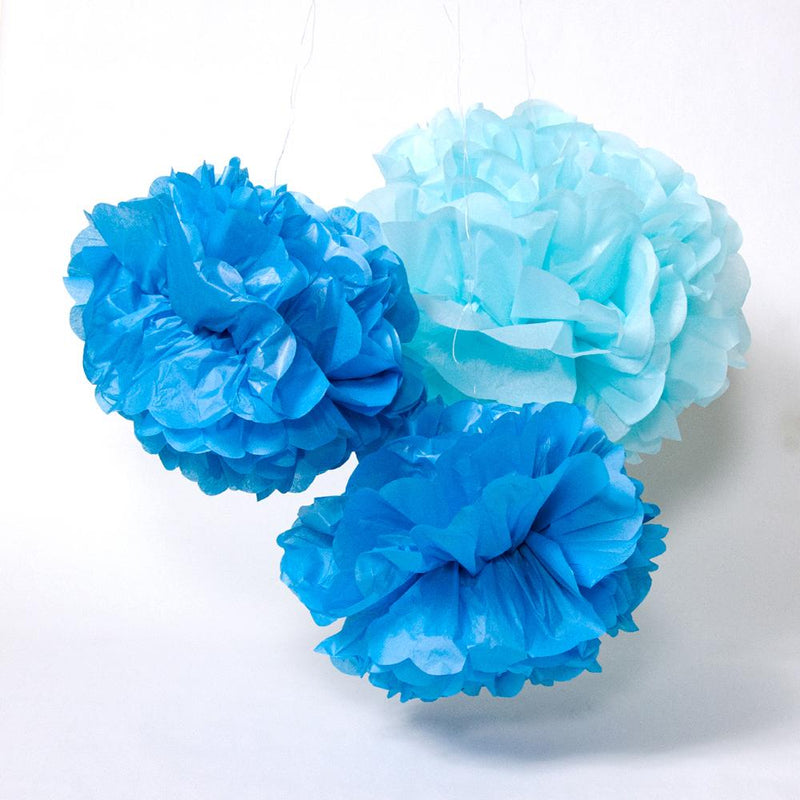 A set of 3 paper pom poms with a light and dark blue colour