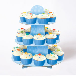 A blue polkadot cake stand covered in cupcakes