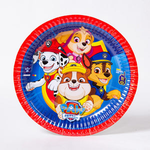 A round paper party plate featuring the Paw Patrol characters