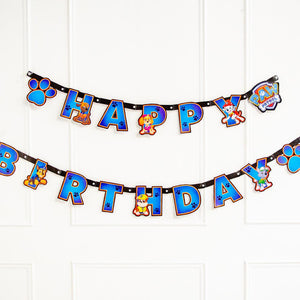 A Happy Birthday party banner featuring all the characters from the Paw Patrol TV show