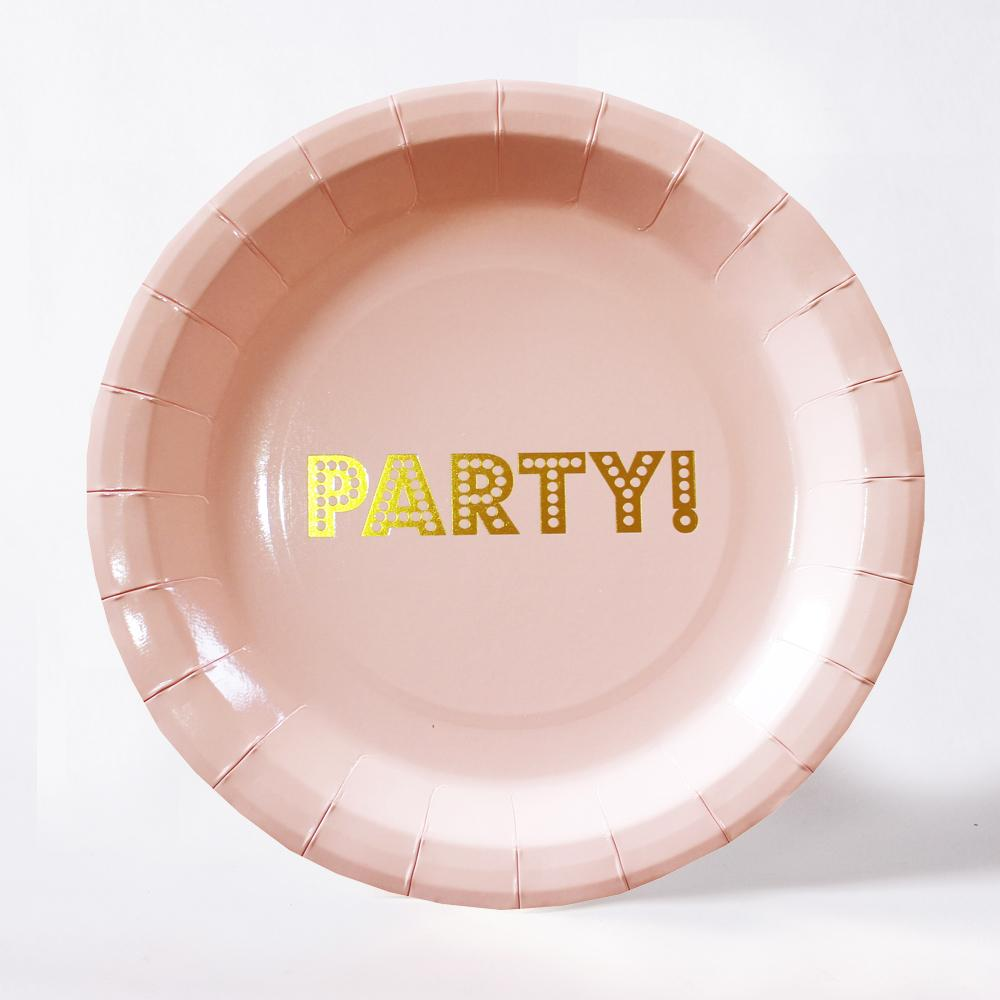 "A round pink paper party plate with a gold foil ""Party!"" message in the centre"