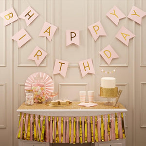 "A pink ""Happy Birthday"" party bunting with flag pennants"