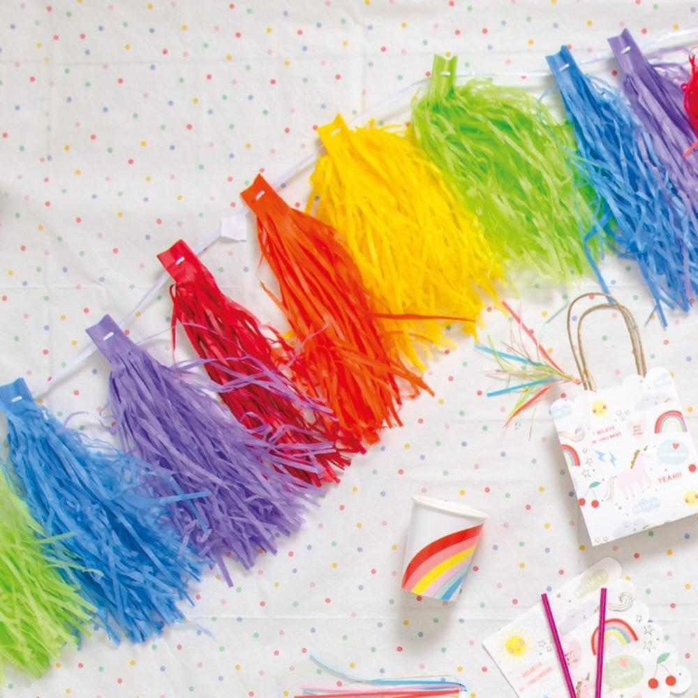 A party garland with rainbow-coloured tissue tassels