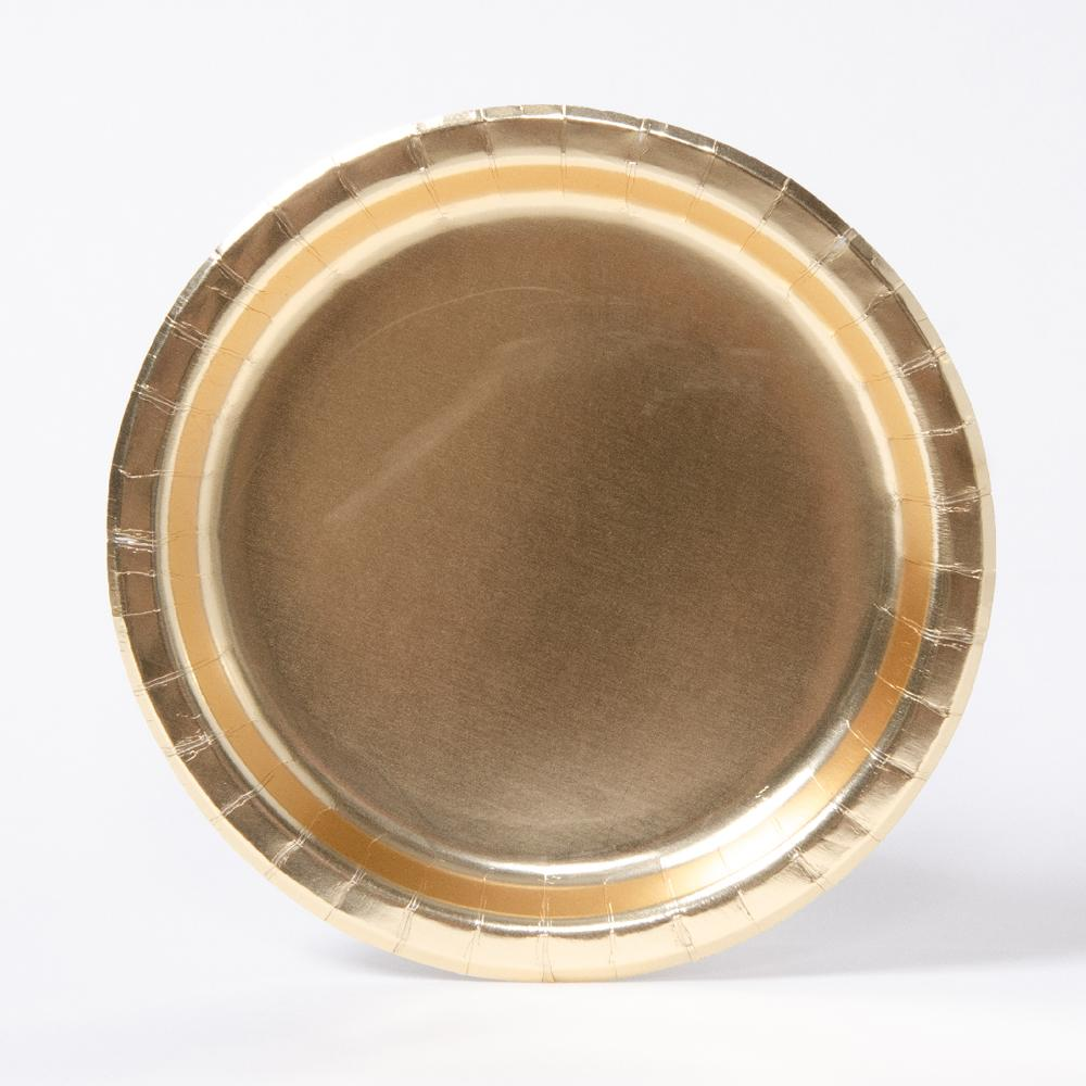 A round party plate with a metallic gold finish