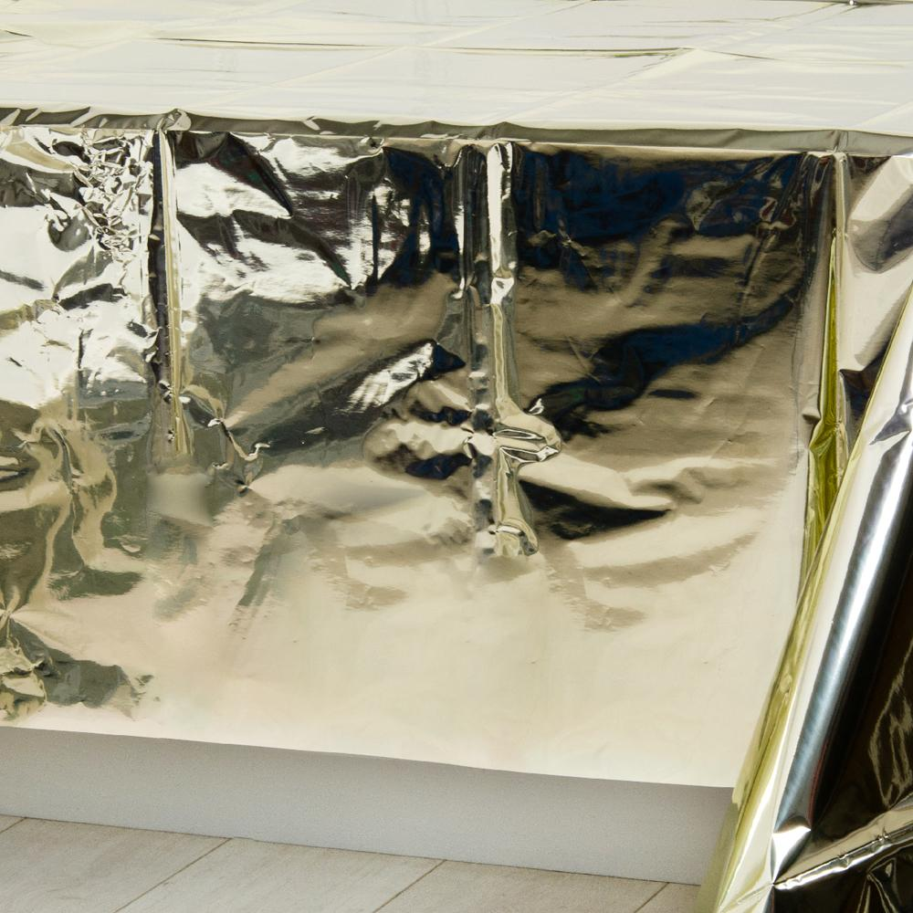A shiny gold plastic table cover