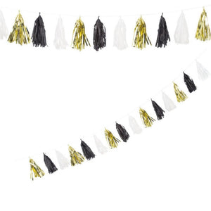 A metallic gold, black, and white tassel party garland
