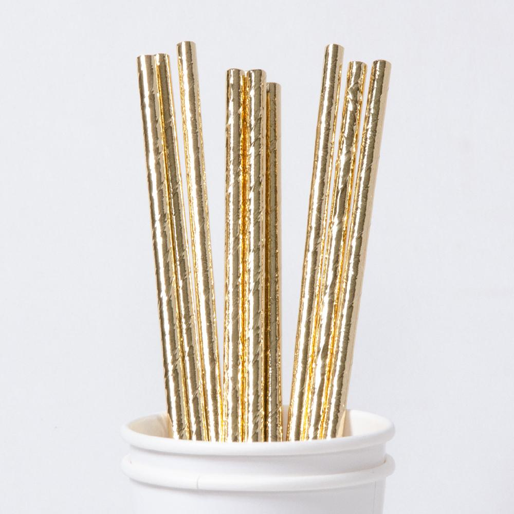 A collection of metallic gold paper straws in party cup