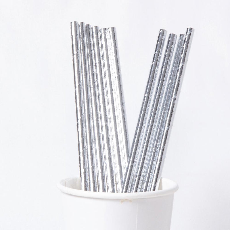 A cup full of silvery paper party straws