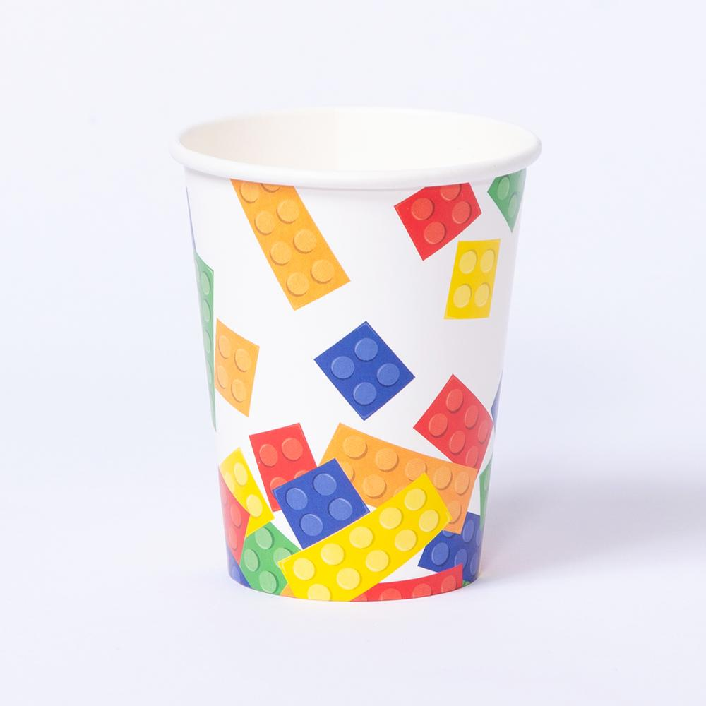 A white party cup with a lego-block type design
