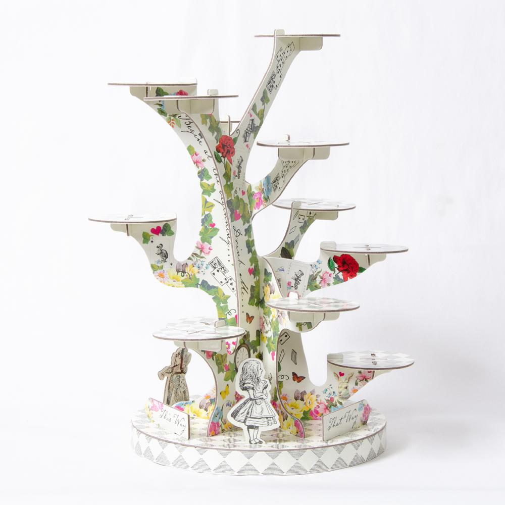 A large, tree-shaped treat stand with an Alice in Wonderland-theme