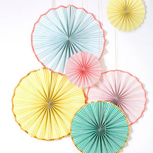 A set of round paper fan decorations in a variety of colours, with a rose gold trim