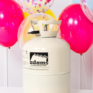 A helium canister surrounded by colourful latex party balloons