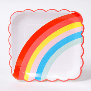 A square, scalloped-edge party plate featuring a colourful rainbow design