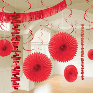 A party room decorated with a variety of bright red party pieces