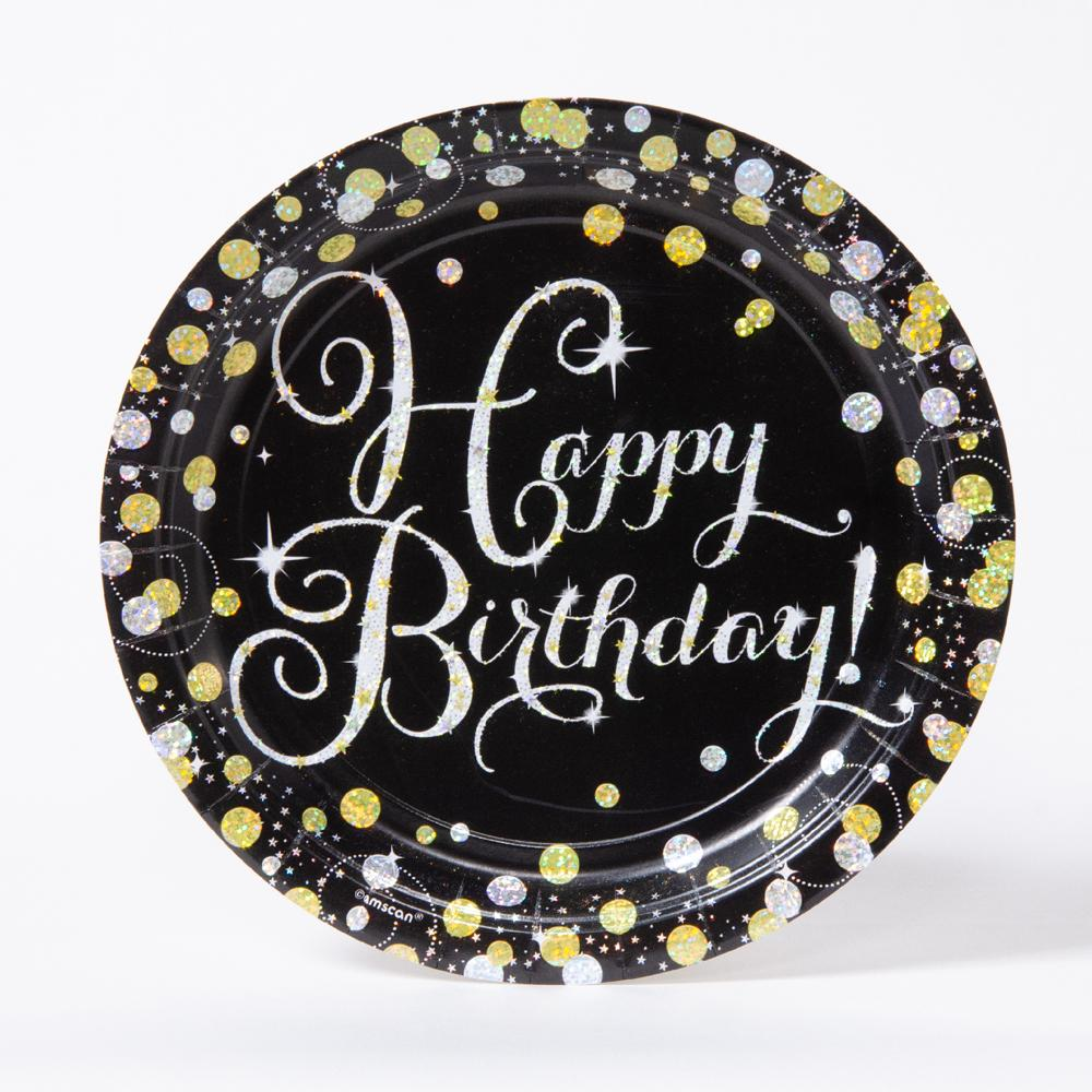 A round milestone party plate with a birthday greeting and silver and gold dots decoration