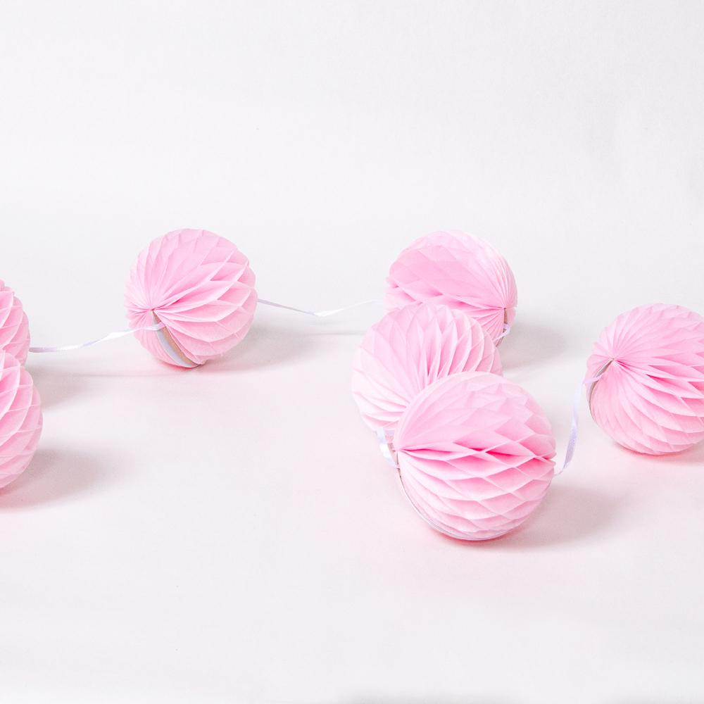 A bunch of light pink party pom poms