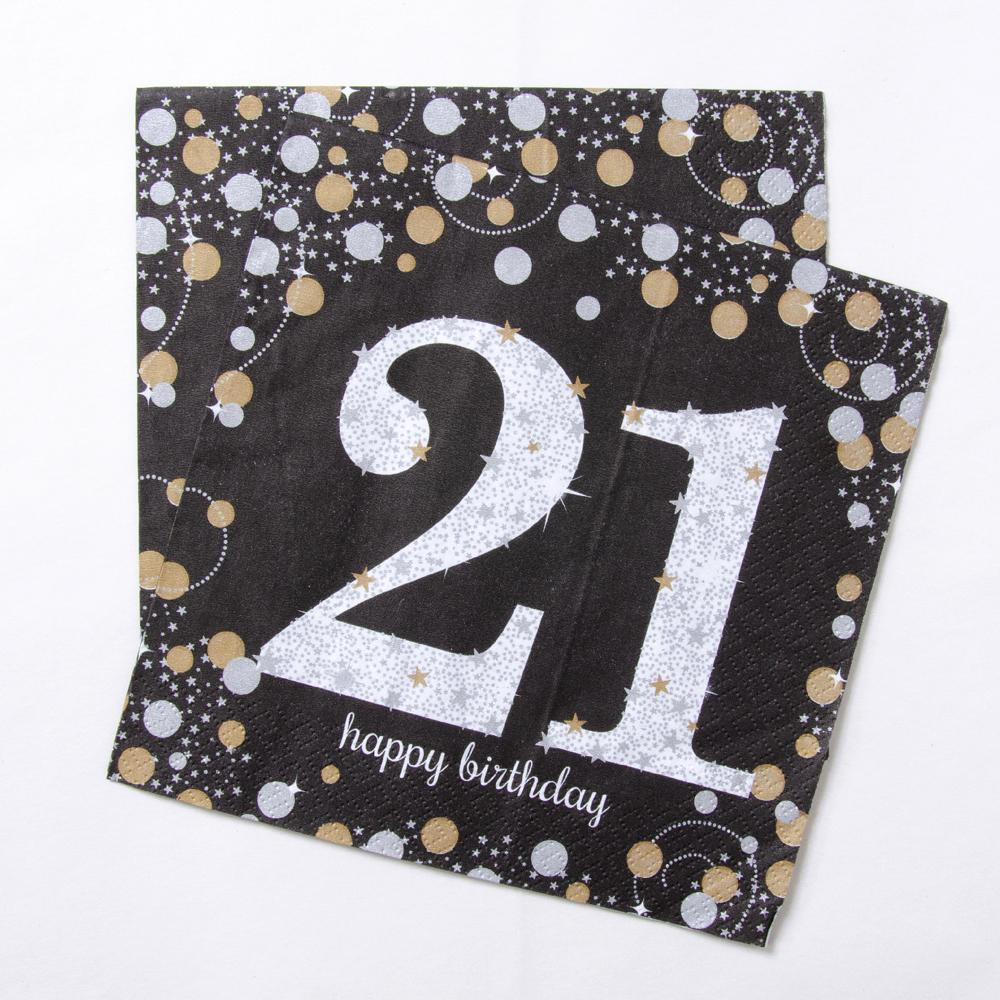 A set of black, silver, and gold 21st birthday party napkins