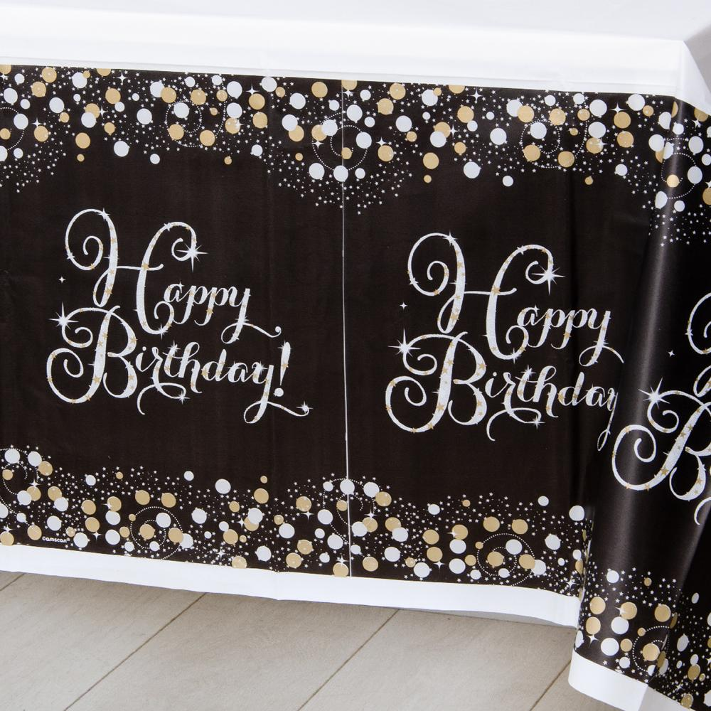A stylish black, gold, and silver birthday tablecover