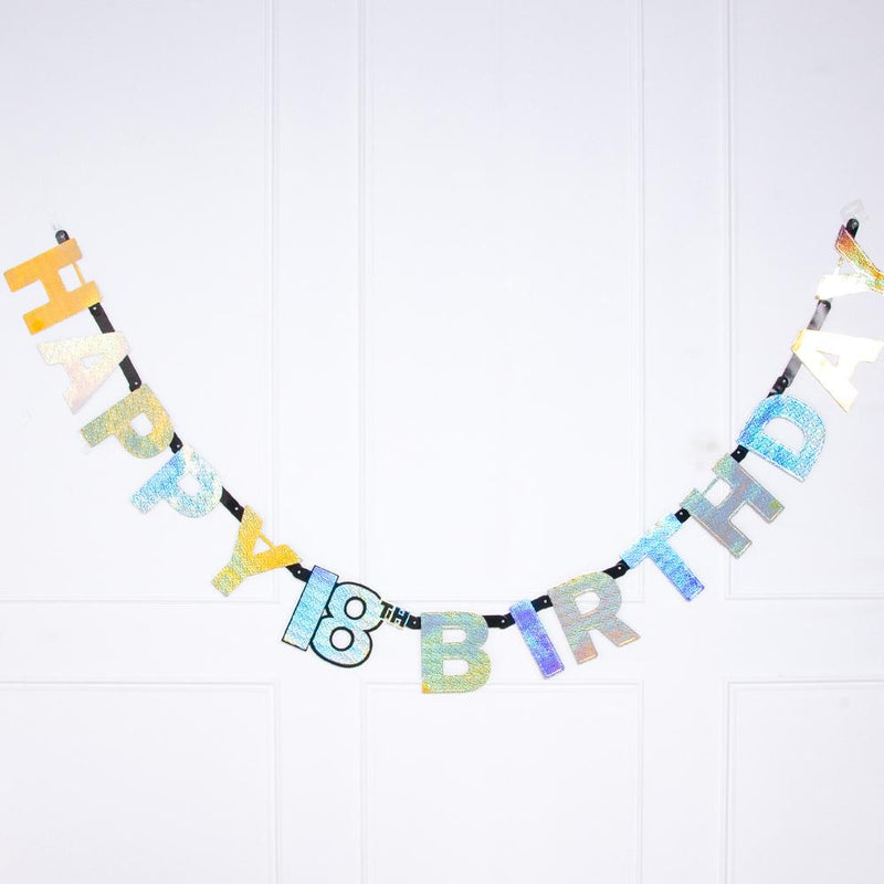 A gold foil 18th birthday letter banner featuring a