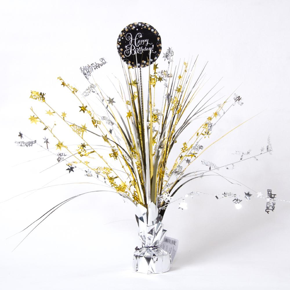 "A stylish party centrepiece spray with gold and silver foil tassels and a ""Happy Birthday"" roundel"